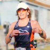 Gail on the run at Beach to Battleship 70.3 mile triathlon