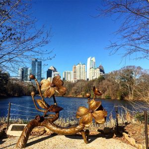 Midtown Atlanta skyline from Piedmont Park with dogwood sculpture runninghellip